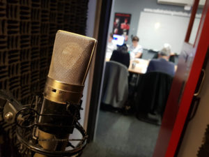 Looking from the voice over booth to the classroom