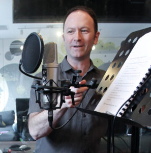 Andy Wells setting up a microphone for the voice over course